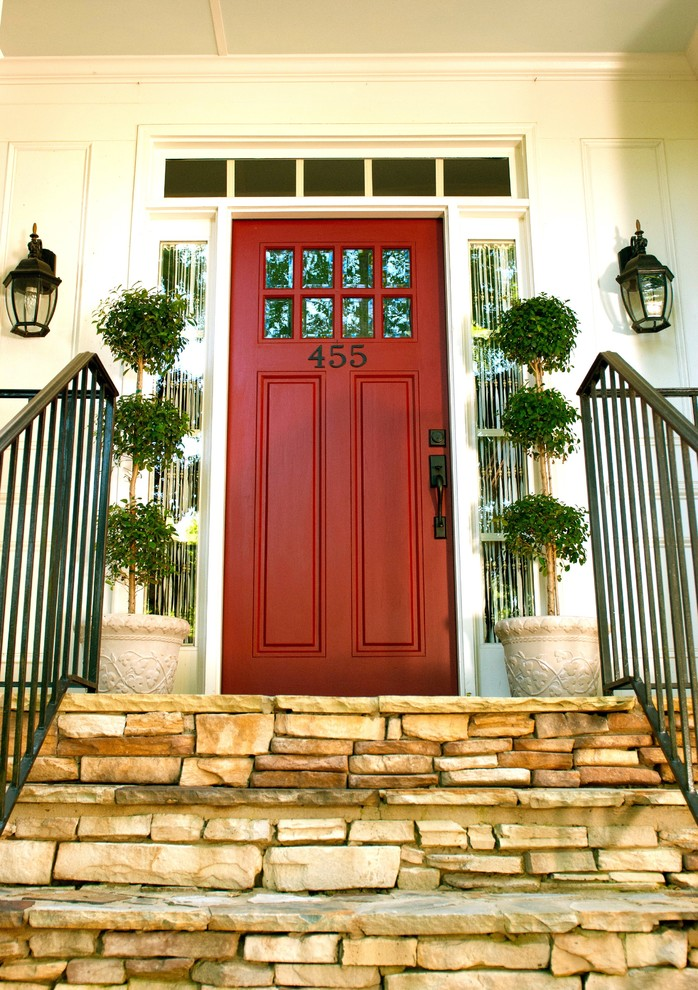 Inspiration for a timeless entryway remodel in Atlanta with a red front door