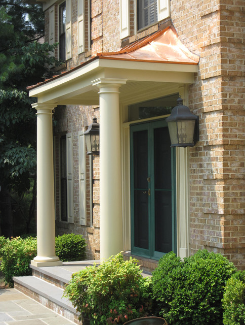 Front portico with copper roof and tapered columns for Entrance roof design