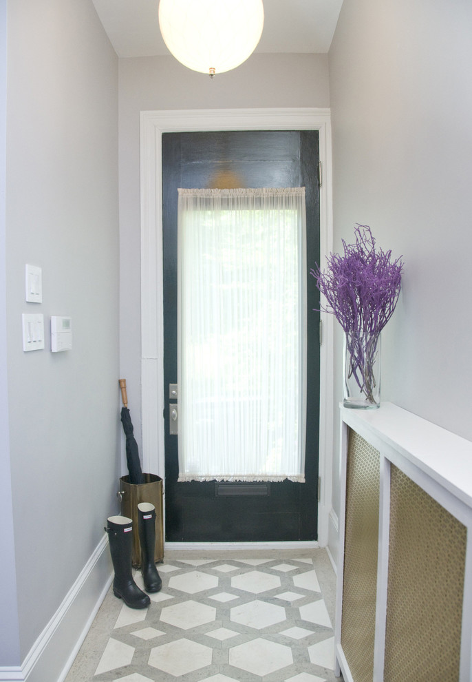 Inspiration for a mid-sized transitional ceramic tile entryway remodel in DC Metro with gray walls