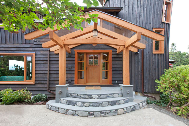 Glass roof timbre frame entry with custom fir door for Entryway roof designs