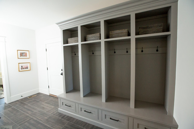 Inspiration for a large transitional porcelain floor and gray floor mudroom remodel in Other with white walls