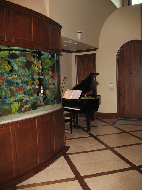 """Grand Entry with a custom 60"""" salt water aquarium. traditional-entry"""