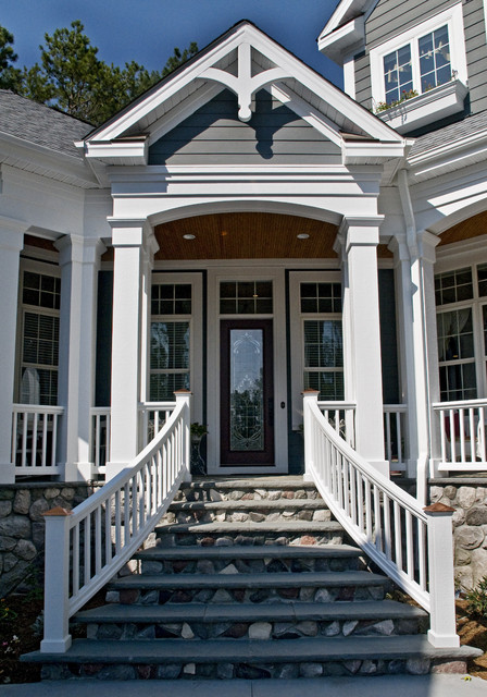 Example of a classic entryway design in Raleigh with a glass front door