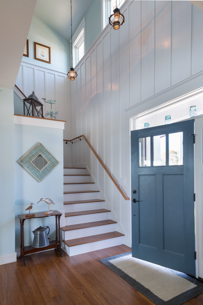 Entryway - beach style entryway idea in Providence with blue walls and a blue front door