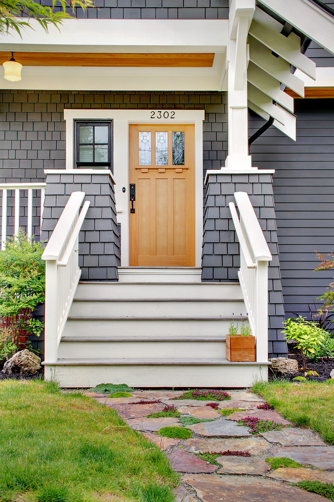Example of an arts and crafts entryway design in Seattle