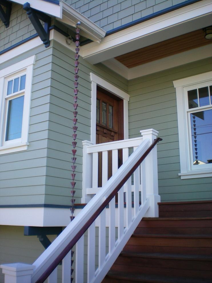 Single front door - craftsman single front door idea in Seattle with a dark wood front door