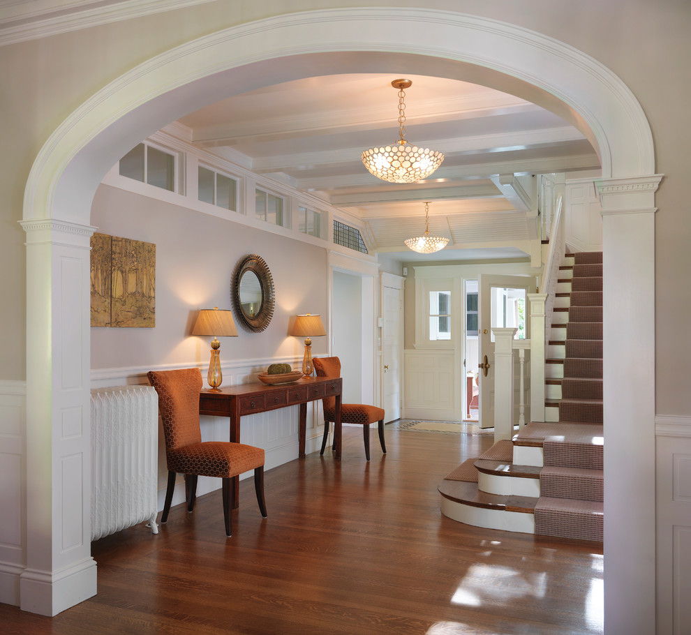 Example of a classic dark wood floor entryway design in Boston