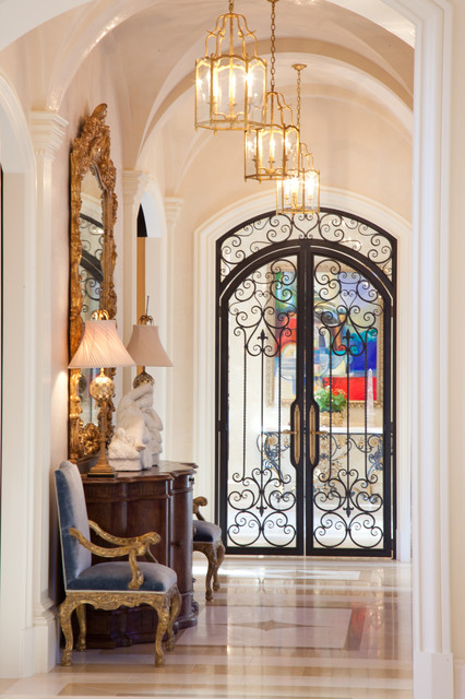 Hallway With Groin Vault Arched Ceiling And Wrought Iron