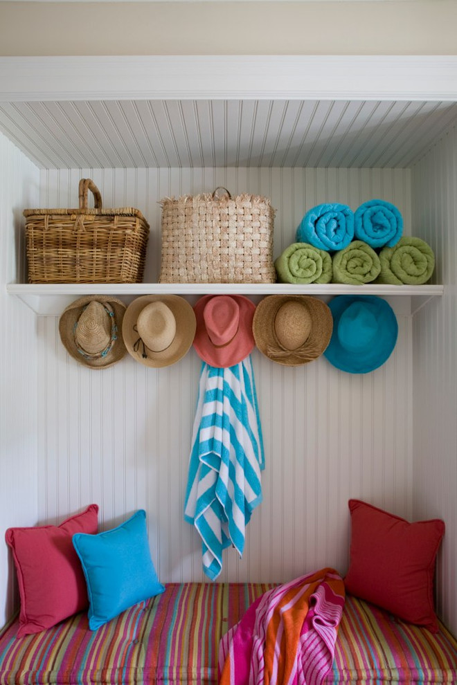 Inspiration for a coastal mudroom remodel in DC Metro with white walls