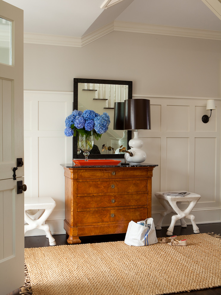Mid-sized transitional dark wood floor foyer photo in New York with white walls