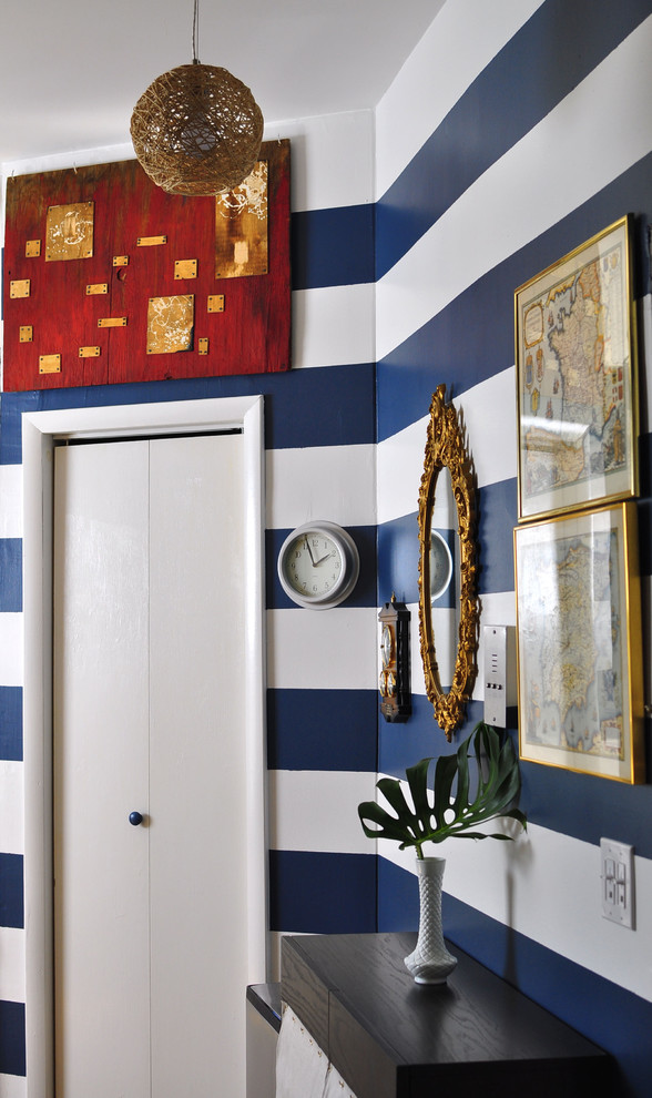 Eclectic entry hall photo in New York