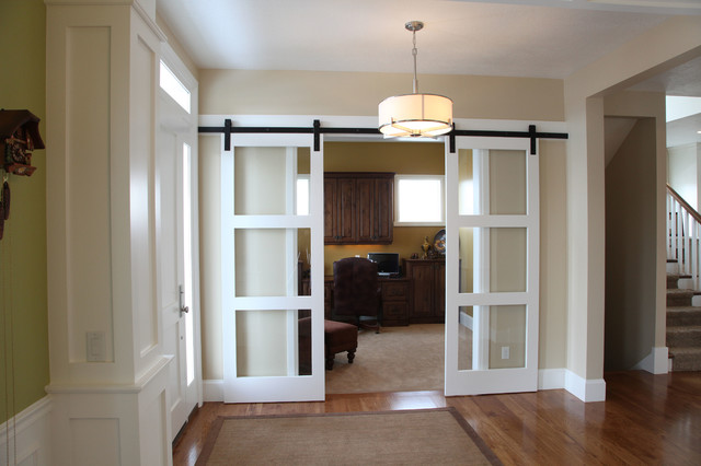 This is an example of a medium sized classic foyer in Salt Lake City with beige walls, medium hardwood flooring, a single front door and a white front door.