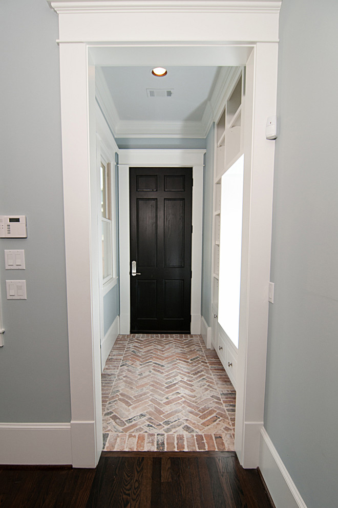 Inspiration for a craftsman brick floor entryway remodel in Houston