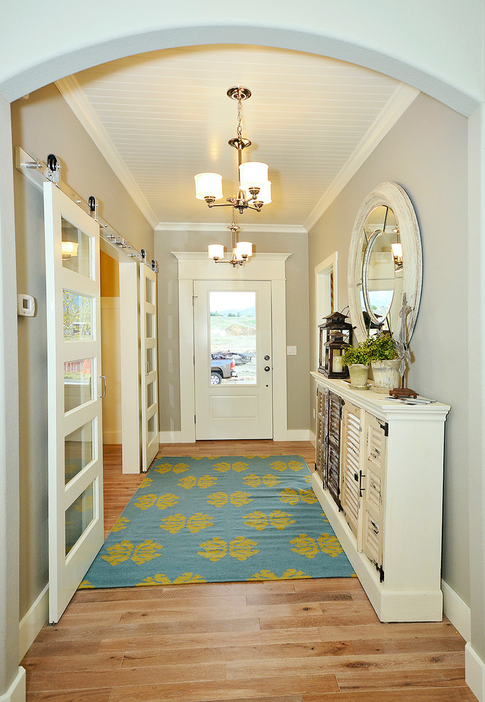 Entry hall - traditional entry hall idea in Denver with gray walls