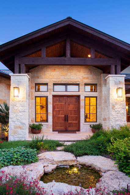 Hill country custom home rustic entry austin by for Custom rustic homes