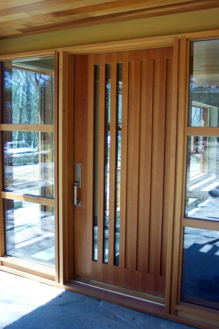Mountain style entryway photo in Burlington with a medium wood front door