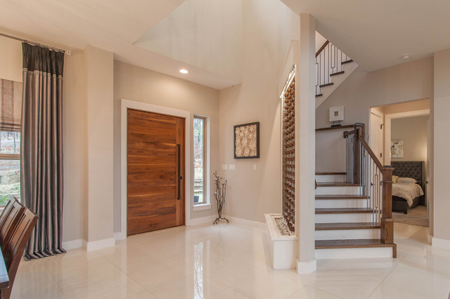 Example of a trendy porcelain floor and white floor entryway design in Dallas with gray walls and a medium wood front door