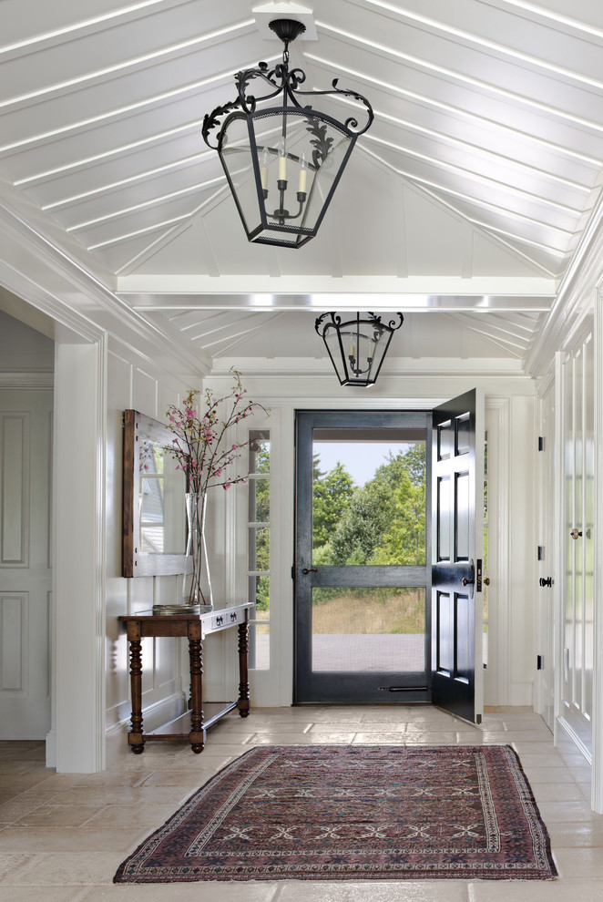 Inspiration for a country single front door remodel in Boston with white walls and a black front door