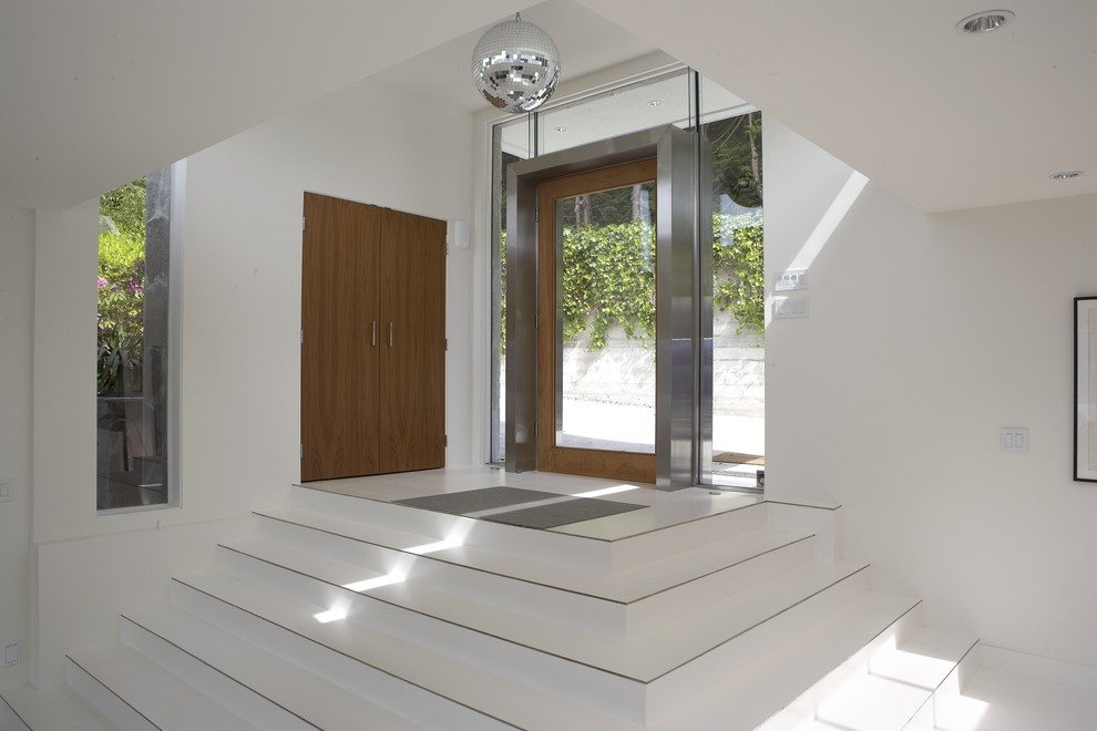 Example of a minimalist single front door design in Vancouver with a glass front door