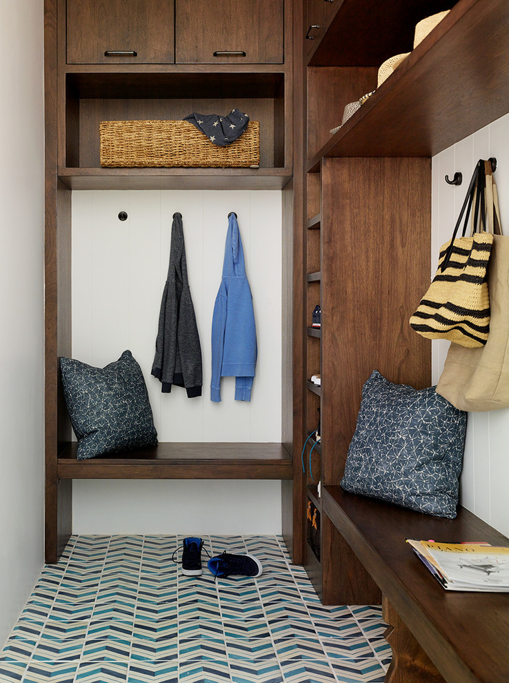 Mudroom - transitional ceramic tile and blue floor mudroom idea in San Francisco with white walls