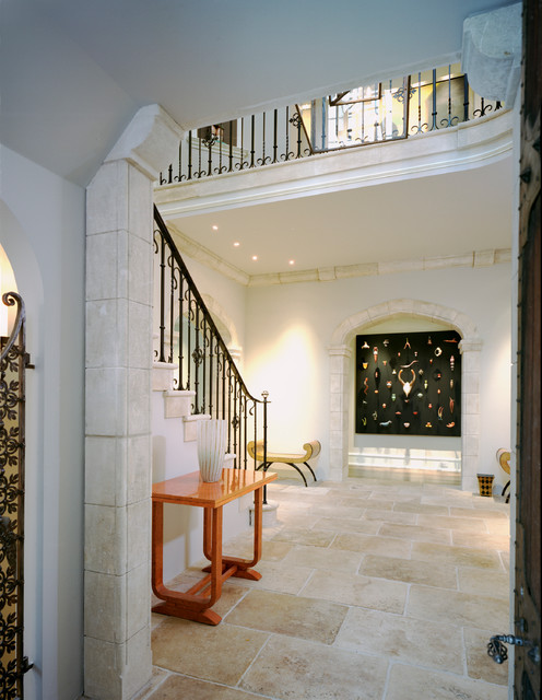Example of a classic foyer design in Philadelphia with beige walls
