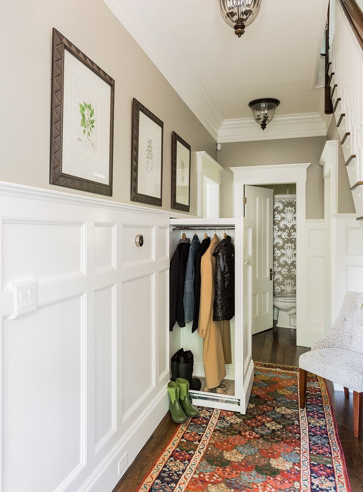 Example of a classic mudroom design in Boston with beige walls