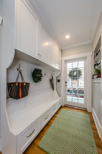 Entryway - traditional medium tone wood floor and brown floor entryway idea in Tampa with beige walls and a white front door