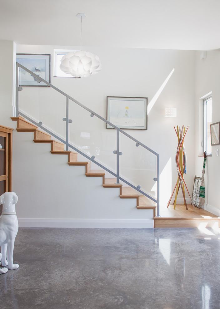 Example of a trendy concrete floor and gray floor entryway design in Austin