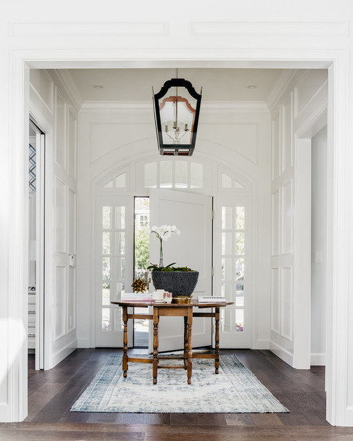 Inspiration for a mid-sized transitional dark wood floor entryway remodel in San Francisco with white walls