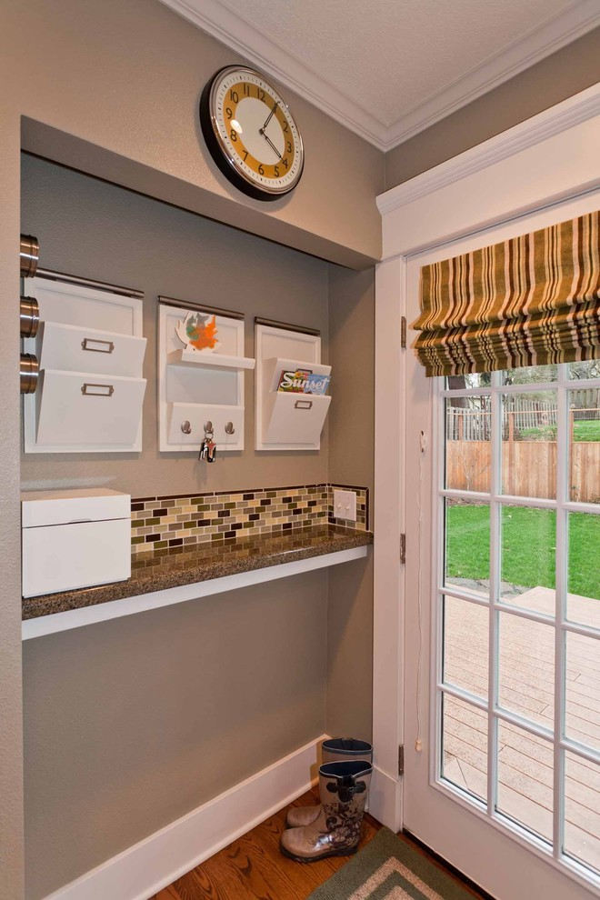 Mid-sized elegant medium tone wood floor entryway photo in Portland with multicolored walls and a glass front door