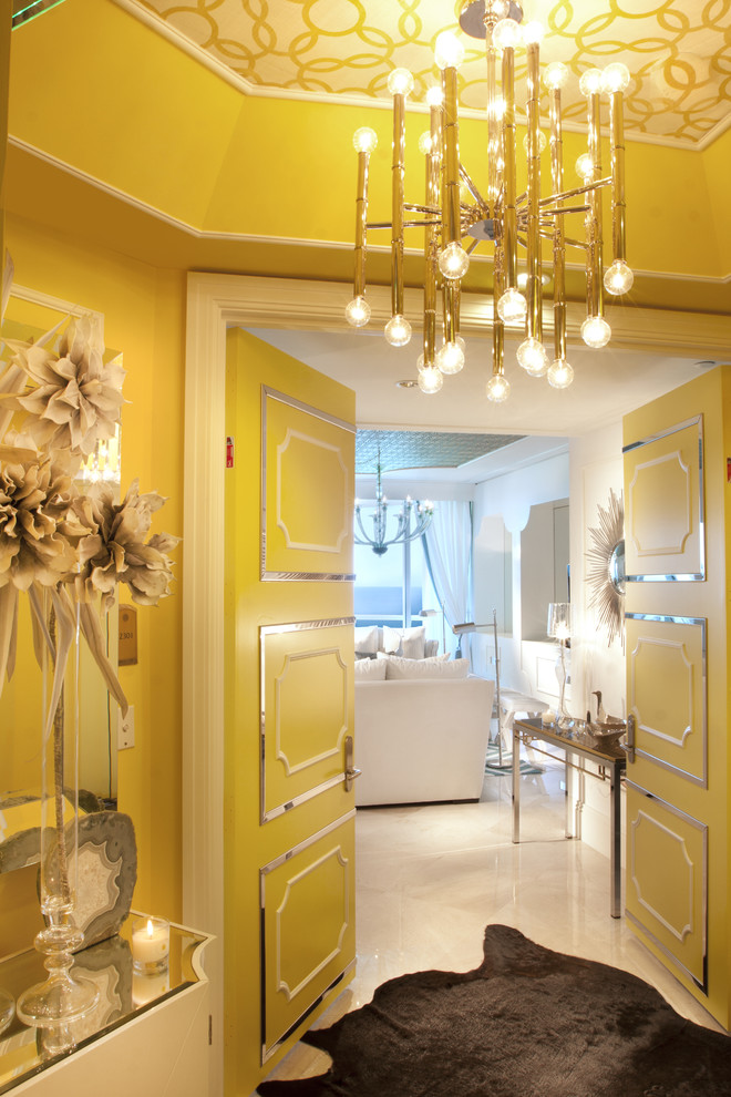 Inspiration for an eclectic white floor entryway remodel in Miami with yellow walls