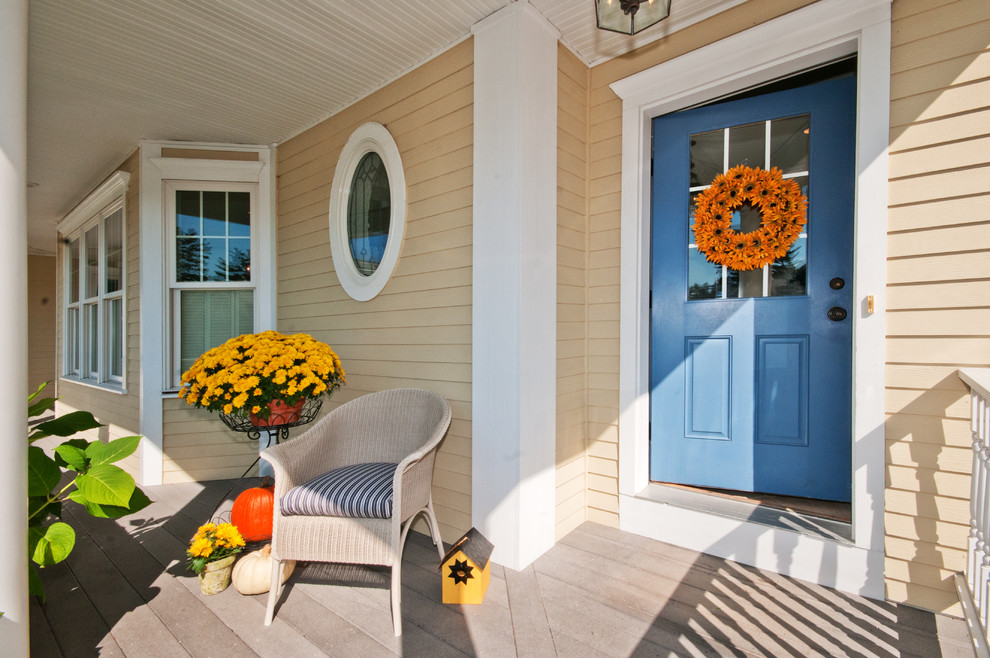 Elegant entryway photo in Boston with a blue front door