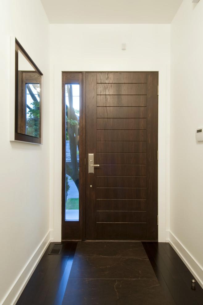 Trendy entryway photo in Toronto with a dark wood front door