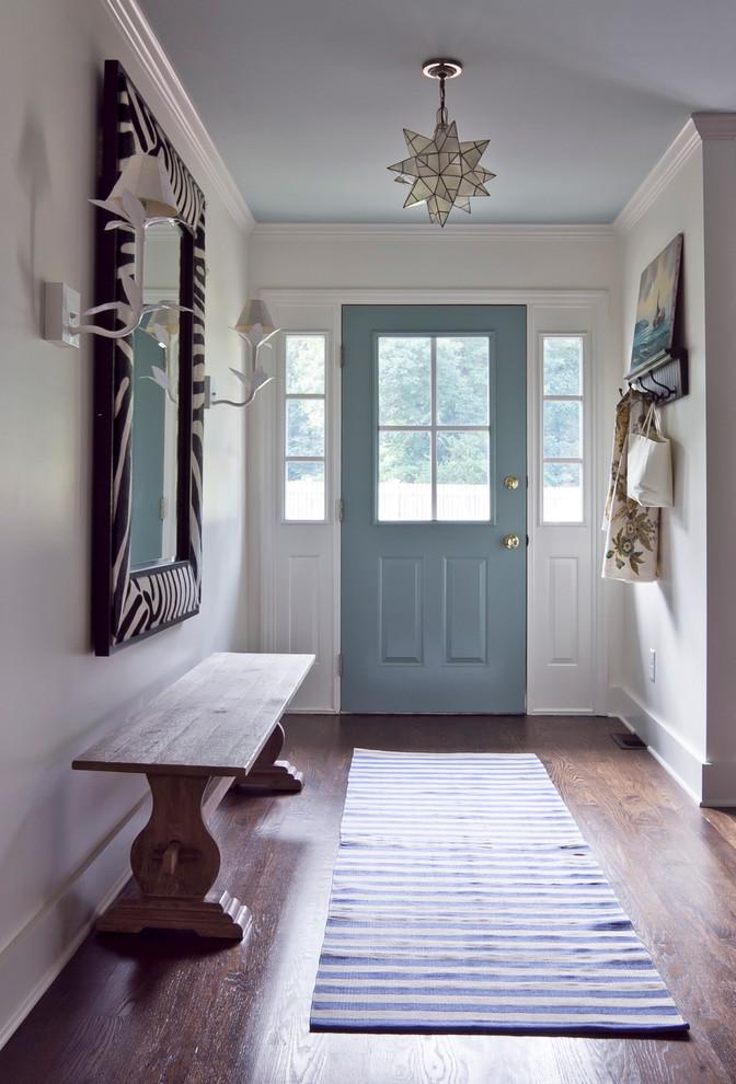 Entryway - eclectic brown floor entryway idea in Atlanta with a blue front door
