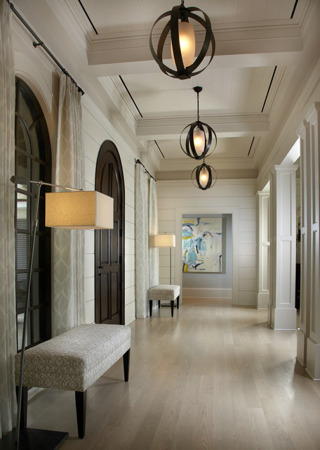 Design ideas for a large classic foyer in Miami with white walls, light hardwood flooring, a dark wood front door and a single front door.