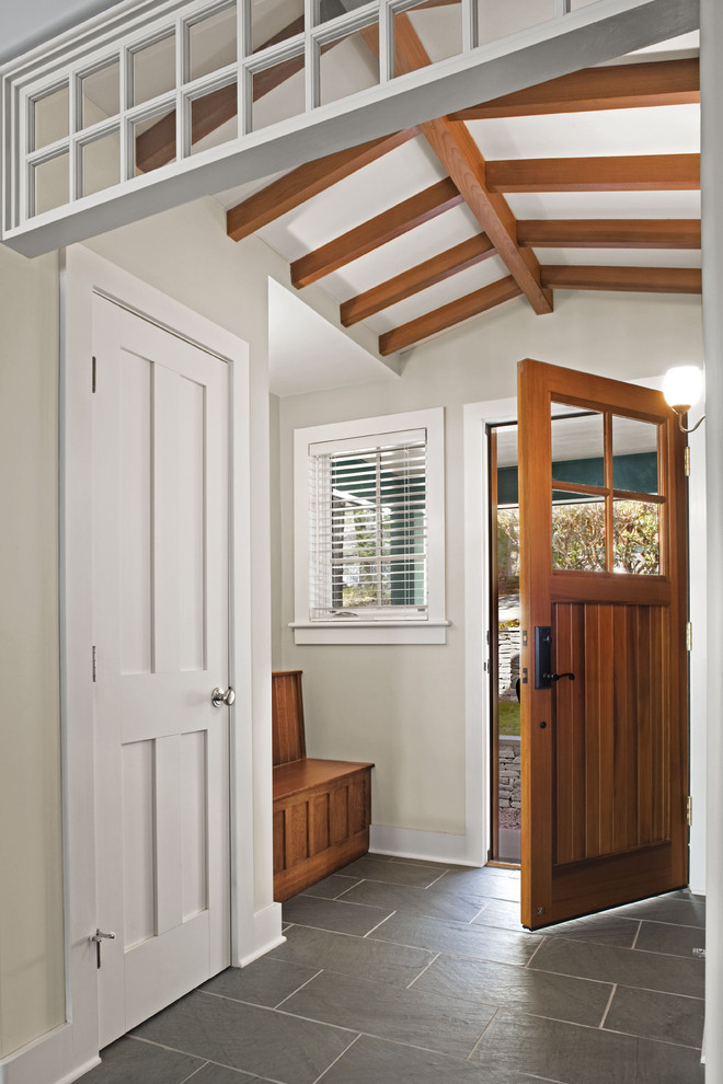 Single front door - transitional slate floor single front door idea in Bridgeport with a medium wood front door