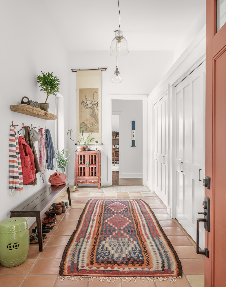 Inspiration for a transitional terra-cotta floor mudroom remodel in Portland Maine with white walls