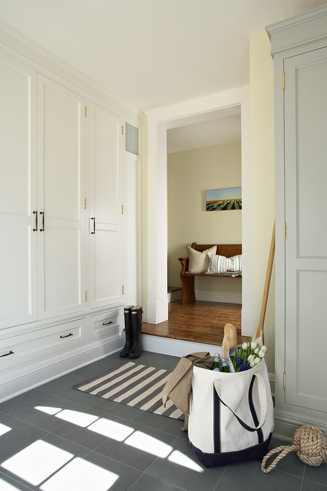 Inspiration for a timeless slate floor mudroom remodel in Minneapolis