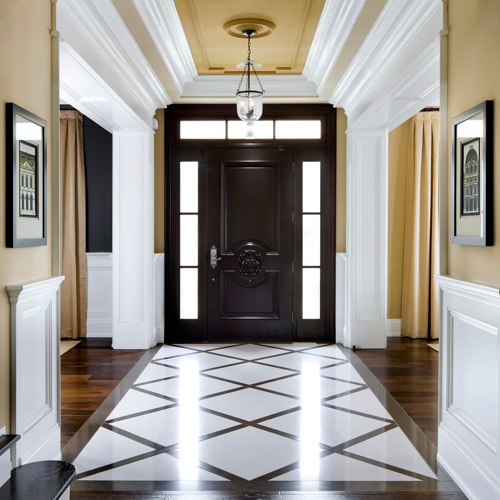 Entryway - traditional multicolored floor entryway idea in Toronto with beige walls