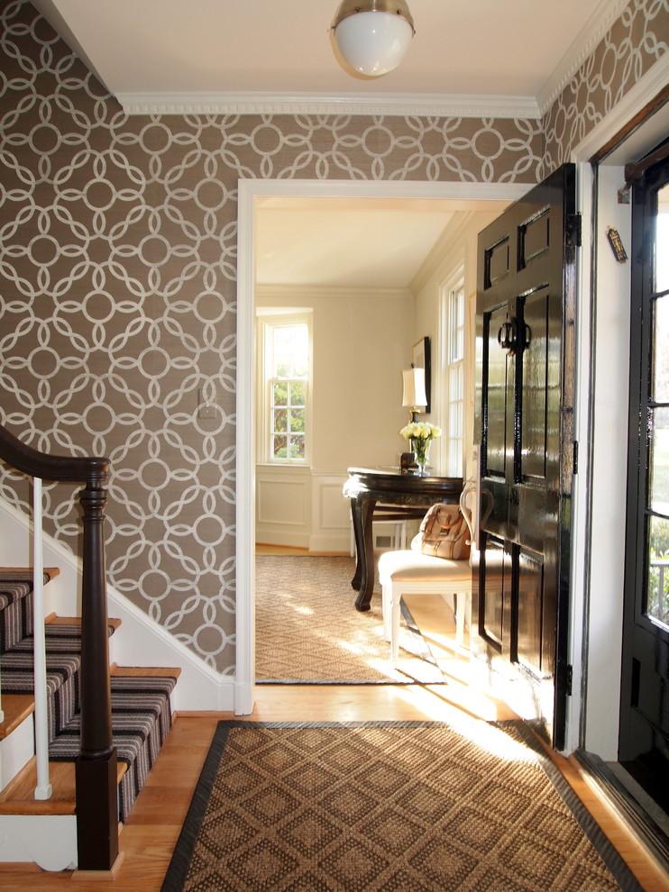 Example of a classic medium tone wood floor single front door design in Baltimore with a black front door