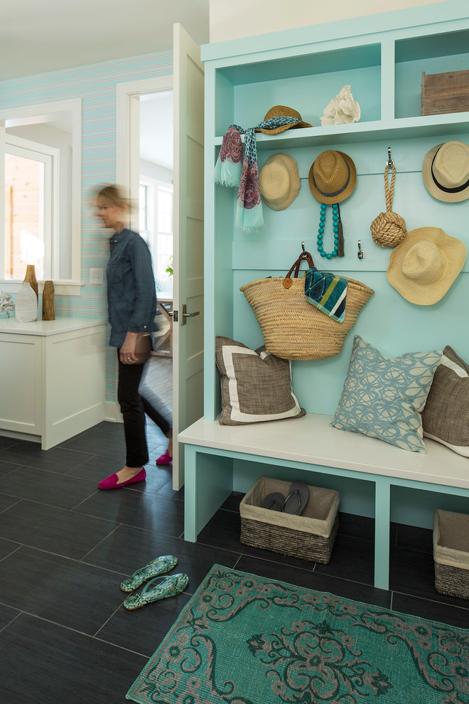 Inspiration for a transitional gray floor mudroom remodel in Minneapolis with blue walls