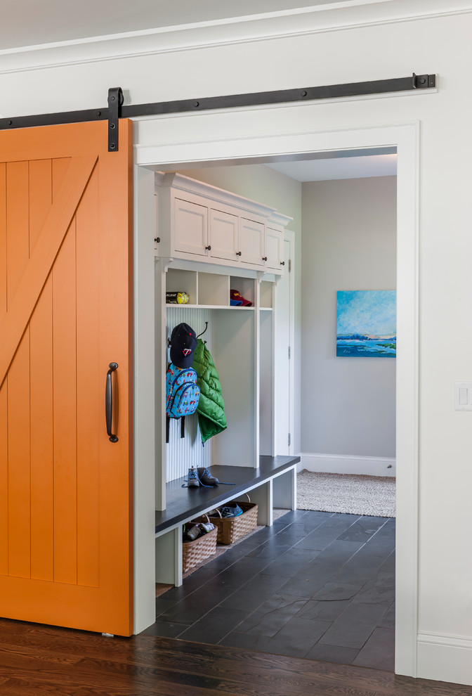 Elegant mudroom photo in Minneapolis with an orange front door and white walls