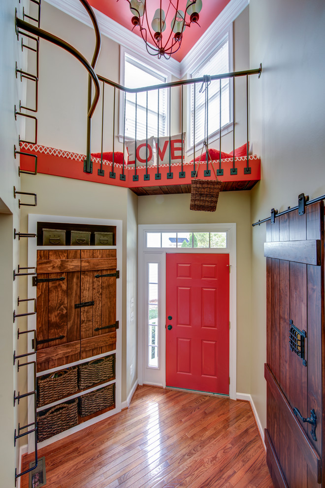 Inspiration for a small transitional dark wood floor single front door remodel in DC Metro with beige walls and a red front door