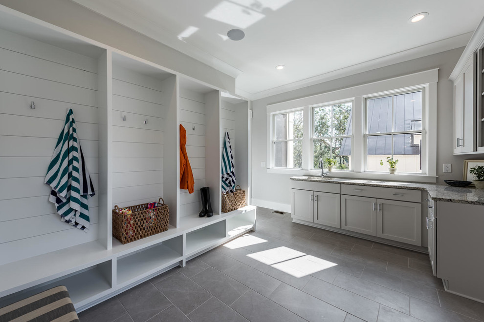 Inspiration for a transitional gray floor mudroom remodel in Charleston with gray walls