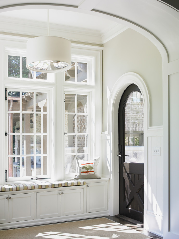 Example of a mid-sized classic mudroom design in Atlanta with beige walls