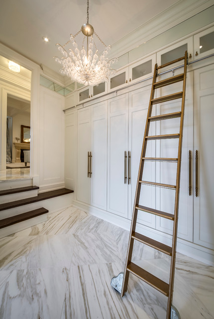 Mudroom - mid-sized modern marble floor mudroom idea in Toronto with white walls