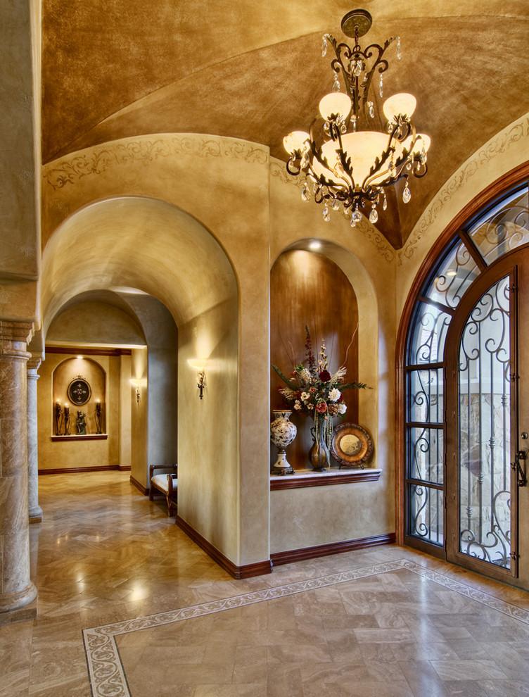 Elegant entryway photo in Austin with beige walls
