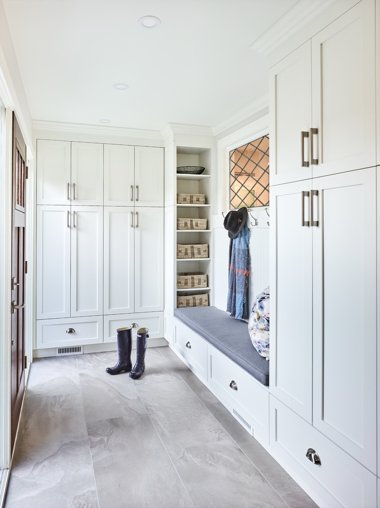 Small transitional porcelain tile and gray floor entryway photo in Vancouver with white walls and a dark wood front door