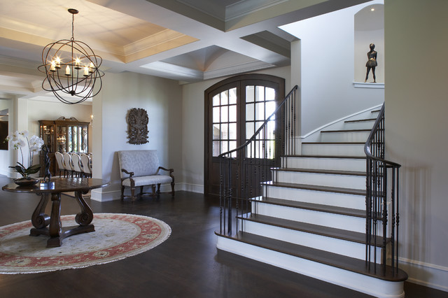 Example of a classic dark wood floor foyer design in minneapolis