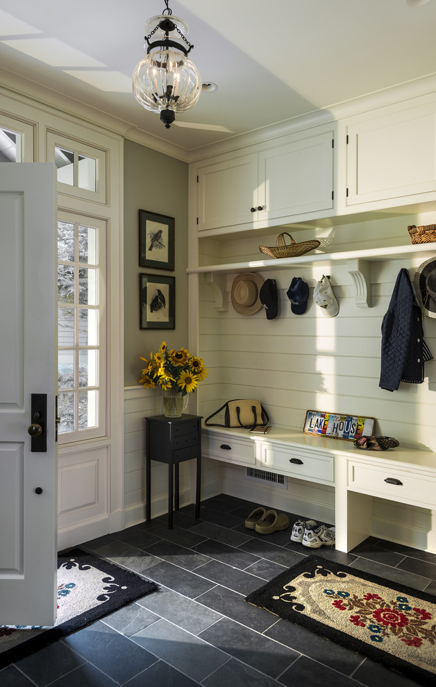 Mudroom - traditional black floor mudroom idea in New York